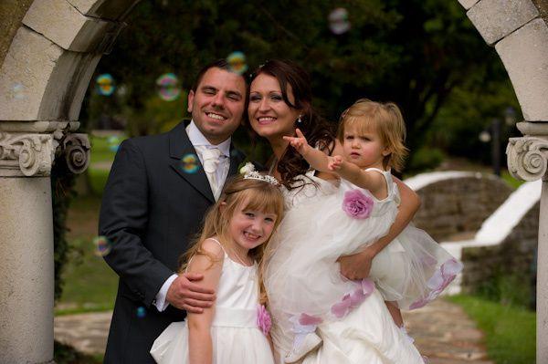 Bride, groom and children