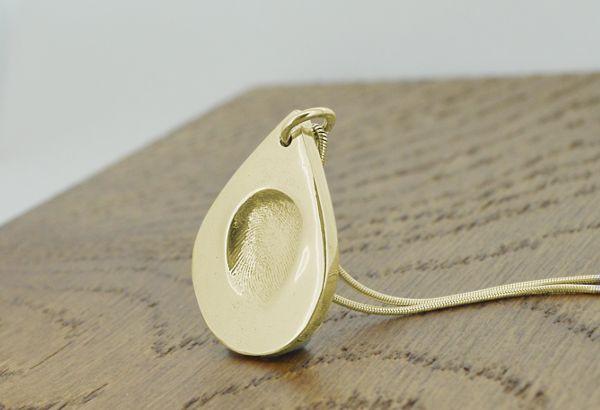 Gold fingerprint droplet