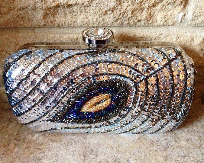 Silver peacock clutch bag