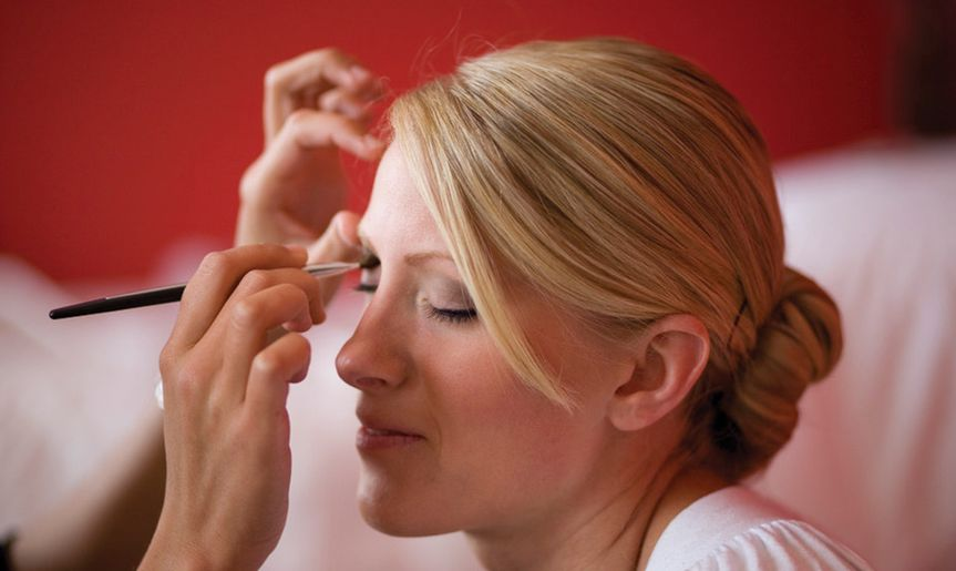 Wedding makeup being applied