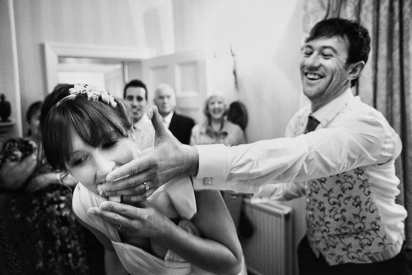 Groom feeds bride cake