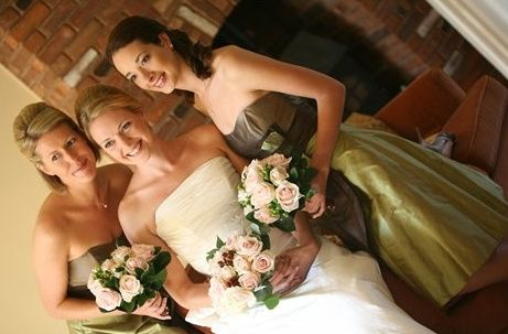 Bride and bridesmaid make up