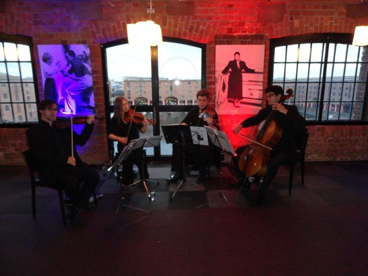 The quartet at corporate event
