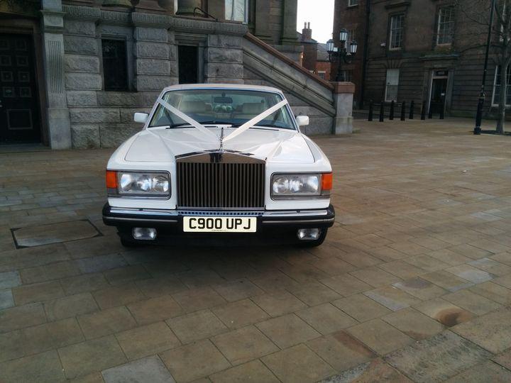 White Rolls Royce wedding car