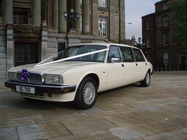 Their white Daimler Limousine