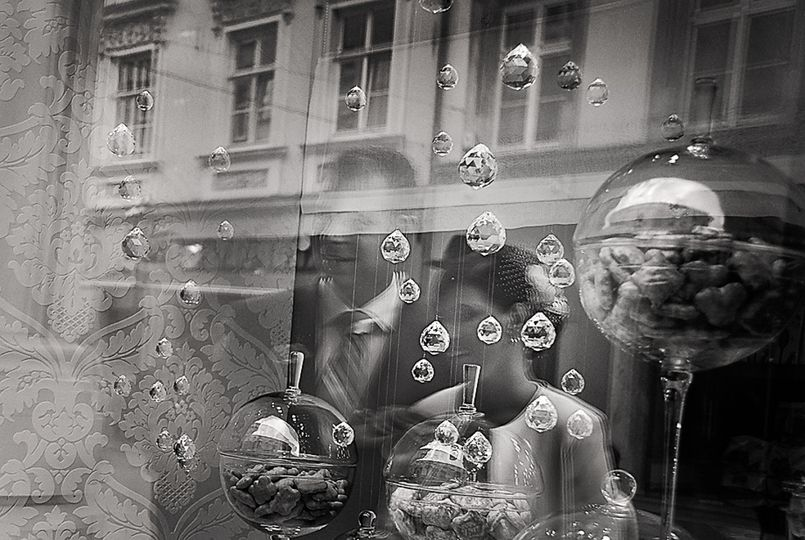 Bride groom window reflection