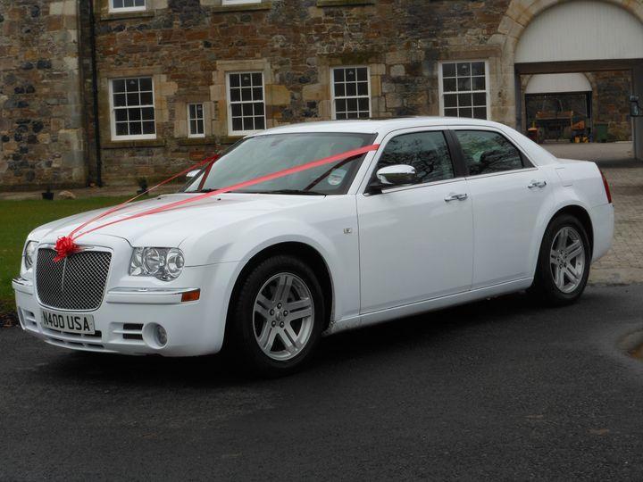 White Chrysler Baby Bentley