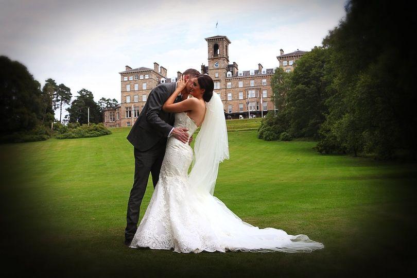 Bride & groom in hotel grounds