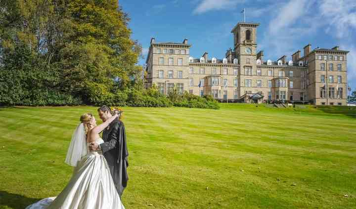Bride & groom on hotel lawns