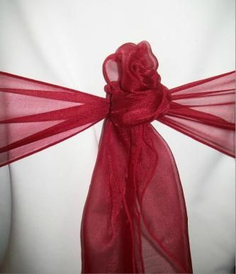 Red sash tied into a rose
