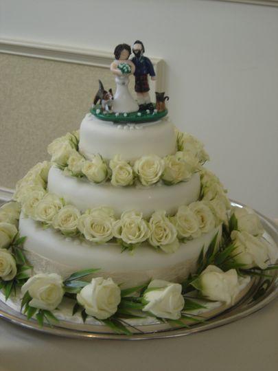 Bride groom dog cat on cake