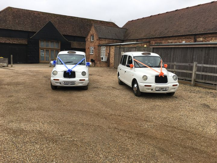 Two Modern White Taxis