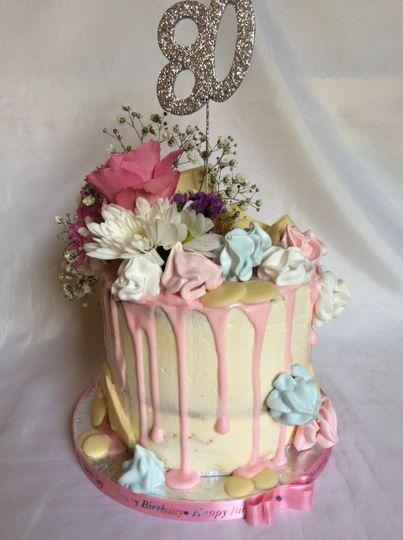 Tall vanilla drip cake