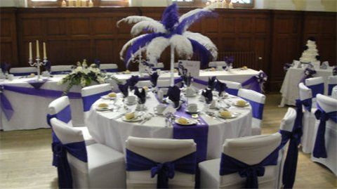 White chair covers with cadbury purple satin sashes and runners, top table decoration, ostrich feathers centrepeieces, pollockshiels burgh hall, glasgow