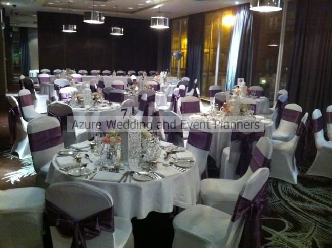 White chair covers with passionflower satin sashes