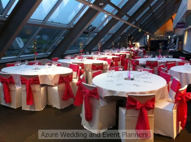 White chair covers with hot pink satin sashes