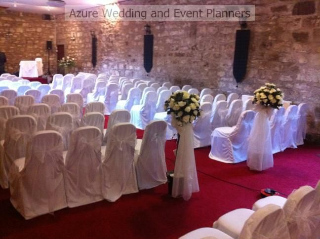 White chair covers with white organza sashes