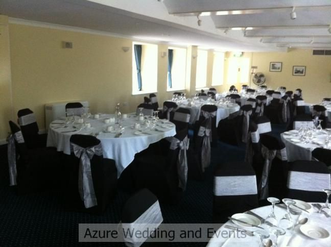 Black chair coves with silver tafetta sashes