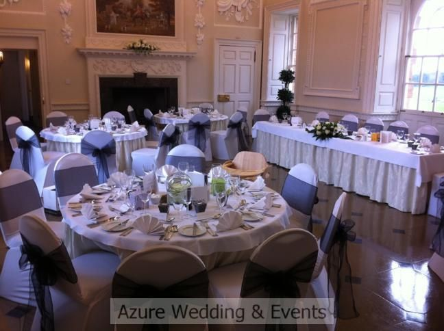 White chair covers with black organza sashes