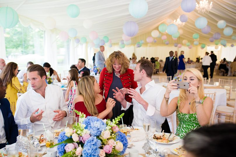 Guests in wedding marquee