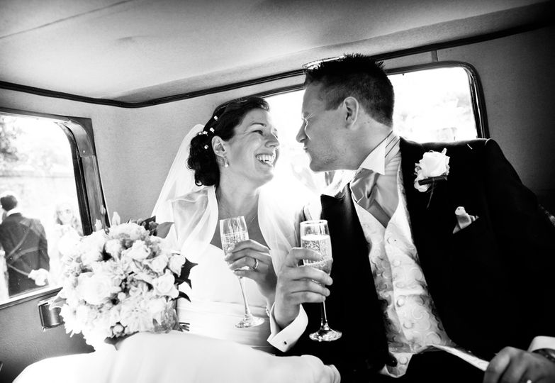 Quirky kiss from groom