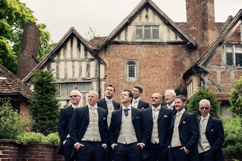 Groom's men infront of House