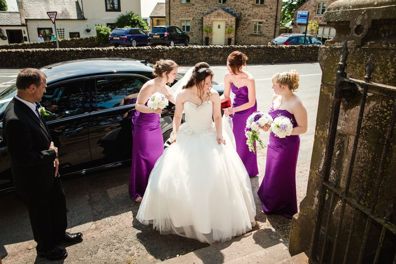 Bride arriving with bridesmaid