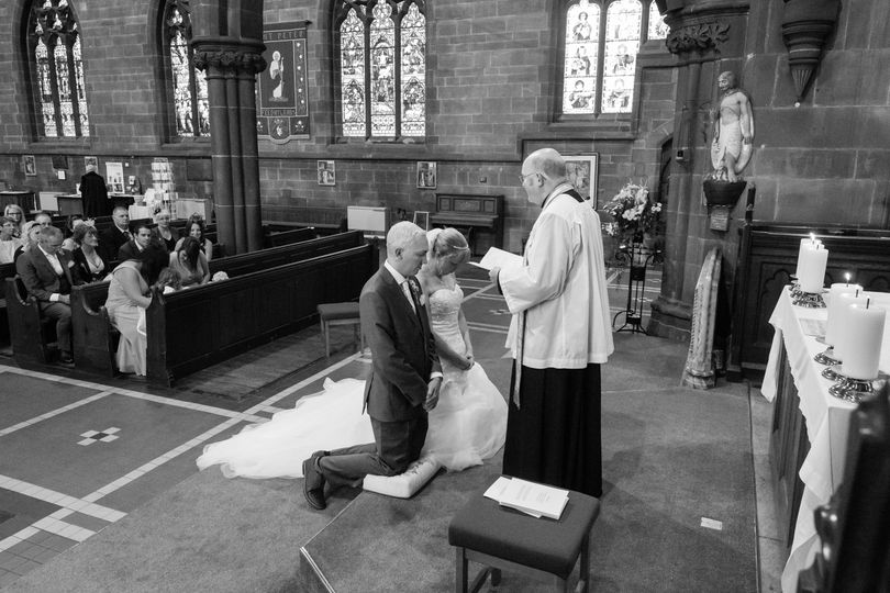 Kneeling before the vicar