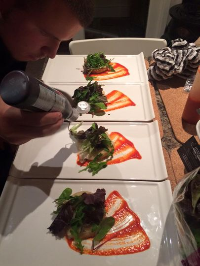 Chef plating up starters