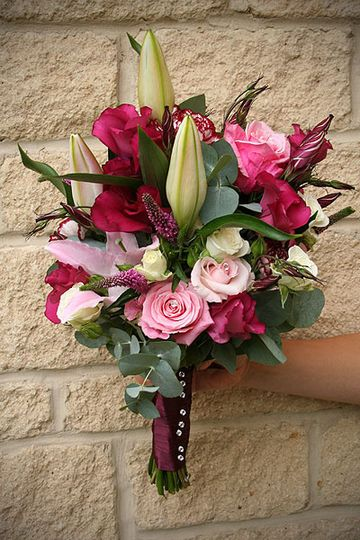 Bridesmaids hand-tied bouquet of Roses and lilies