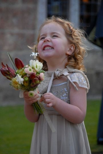 Happy little girl with flowers