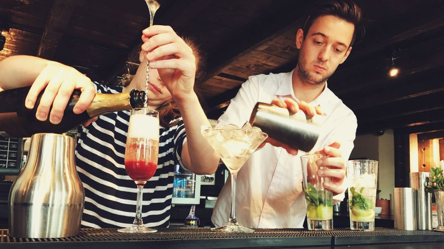 Staff making cocktails