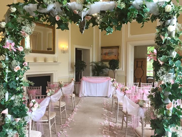 Pink & ivory aisle with arch