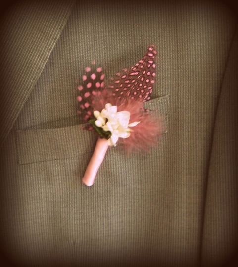 Pink feather buttonhole