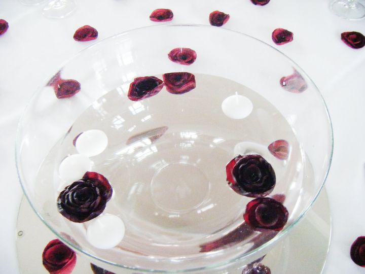 A mini toss bouquet in ruby
