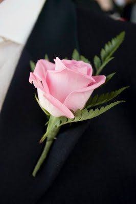 Simple pink roses for the groom