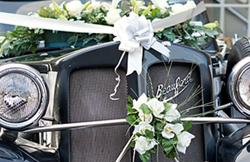 Front of car with flowers