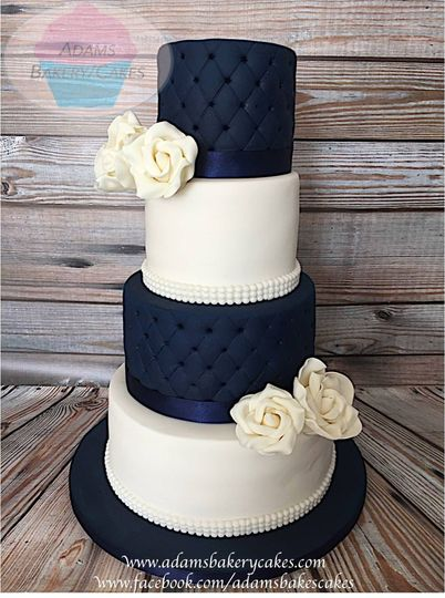 4 tier navy blue and white cak