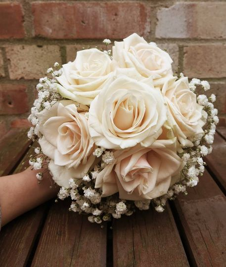 Beautiful soft peach roses teamed with the gentle gypsophila