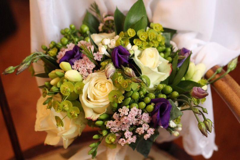 Cream roses with purple accent