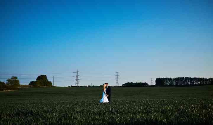 Blue sky bride and groom