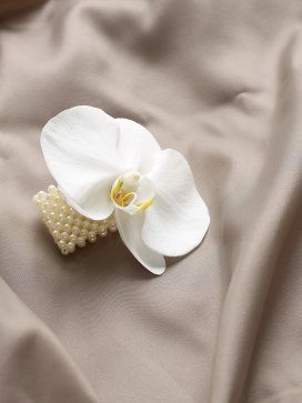 Pure white orchid corsage