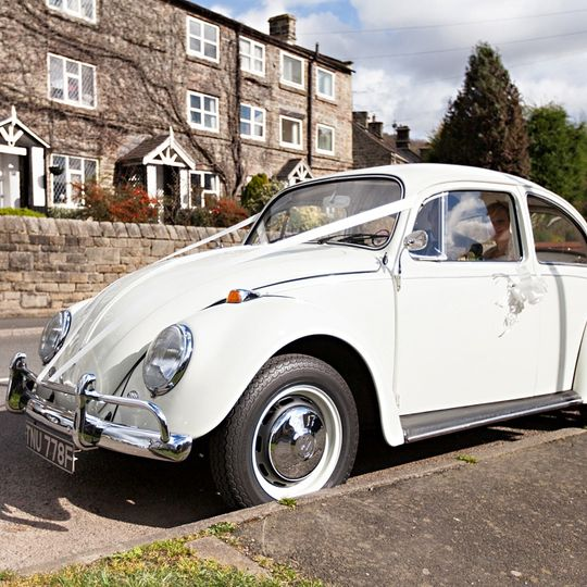 White vw beetle wedding car
