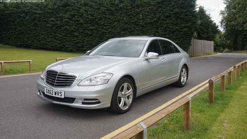 Silver Mercedes s class limo