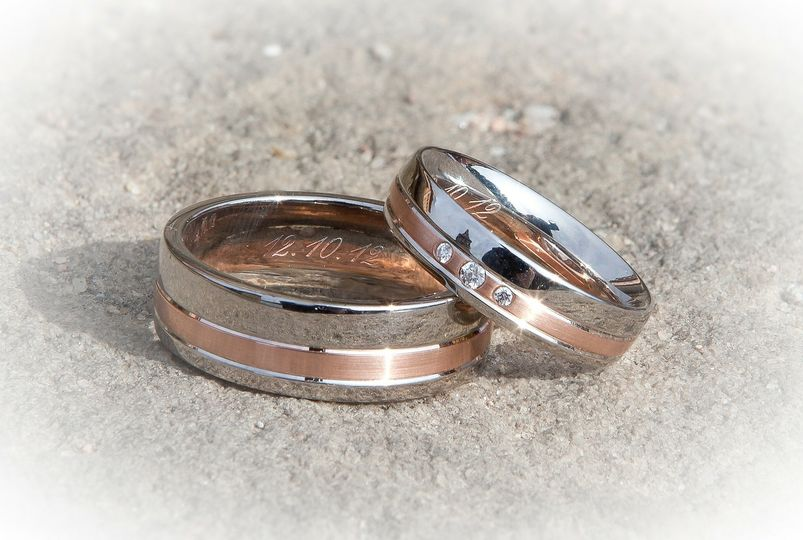His & hers rings in the sand