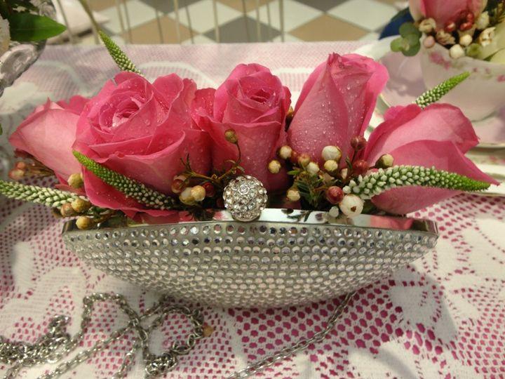 Clutch bag roses centrepiece