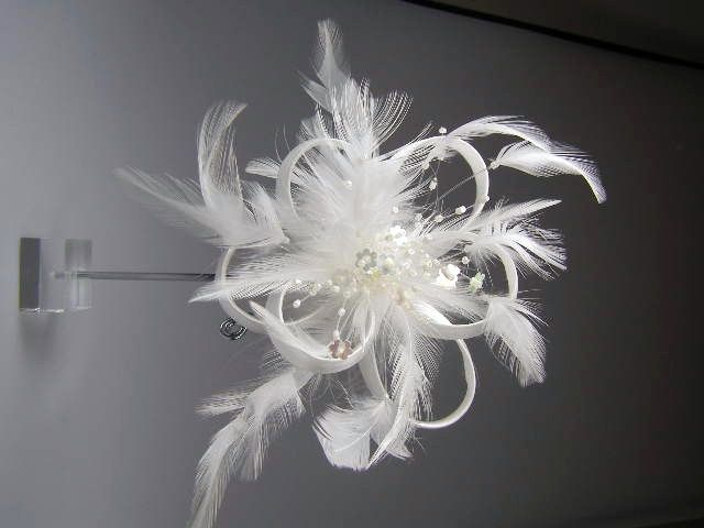 White coiled ribbon feather sequin clip fascinator