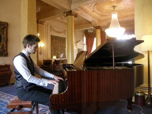Wedding pianist playing for a drinks reception at Down Hall