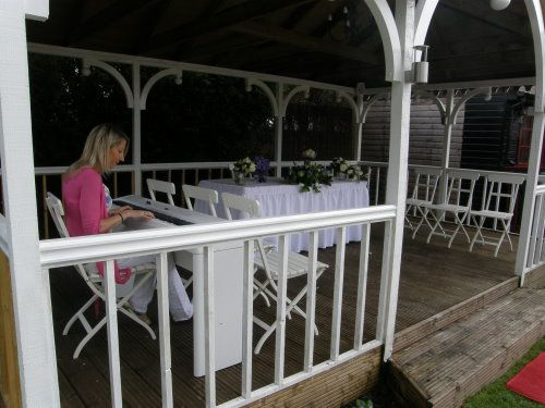 Wedding pianist playing for an outdoor civil ceremony at Hunters Meet