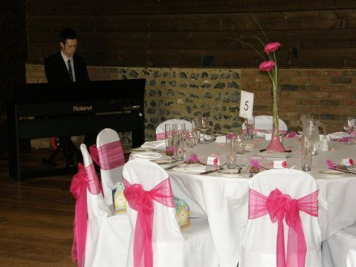 Wedding pianist playing for a wedding breakfast at the White Hart